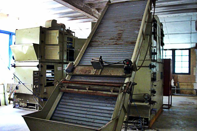 Machinery inside the factory being repaired